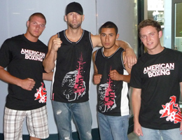 Coach Dave Nielsen with his athletes after weighins before Muay Thai Kickboxing competition