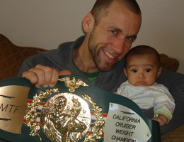Dave Nielsen WCK World Championship Muay Thai IAMTF California Cruiserweight Title belt with daughter.