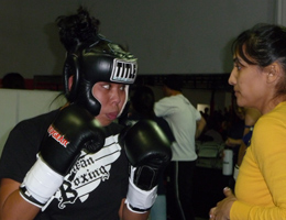 Kru Gina Reyes preparing and working the corner for Irene Estrada's first k-1 rules kickboxing match.