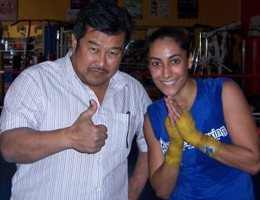 Gina Reyes Muay Thai fighter with Master Toddy